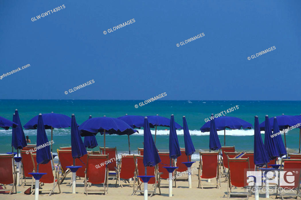 Stock Photo: Beach chairs and beach umbrellas on the beach, Italy.