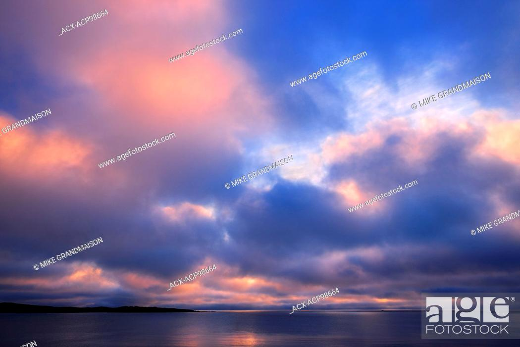 Stock Photo: Clouds at sunrise on the Atlantic Ocean Channel-Port aux Basques Newfoundland & Labrador Canada.