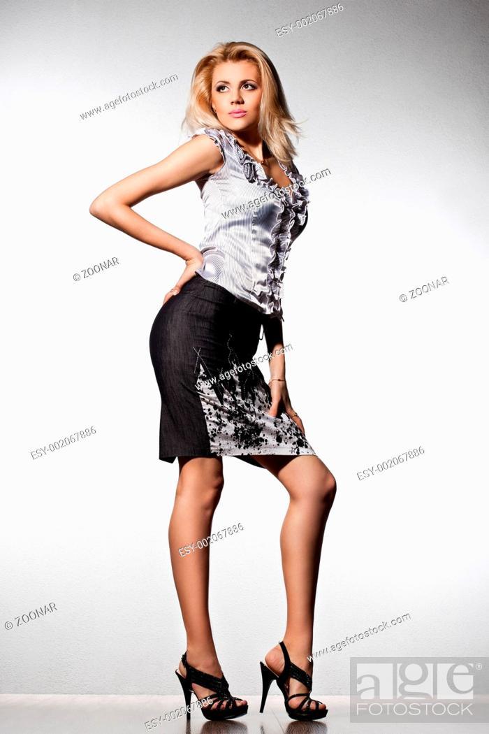 Stock Photo: elegant fashionable woman on grey background.