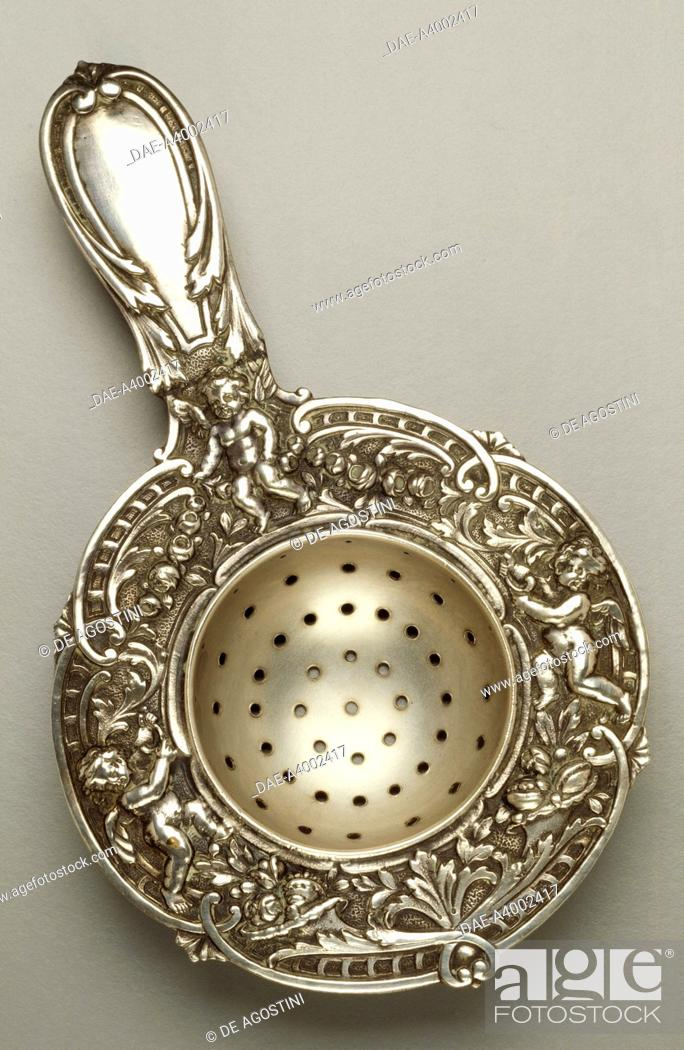 Stock Photo: Silver strainer with cherubs, chased and embossed, 1880. The Netherlands, 19th century.