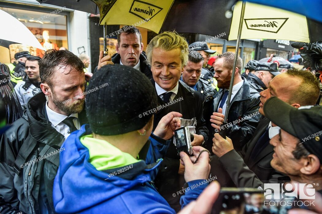 Stock Photo: BREDA - THE NETHERLANDS - MARCH 8: Geert Wilders visit Breda, a week before the election and flyers on March 8, 2017 in Breda.