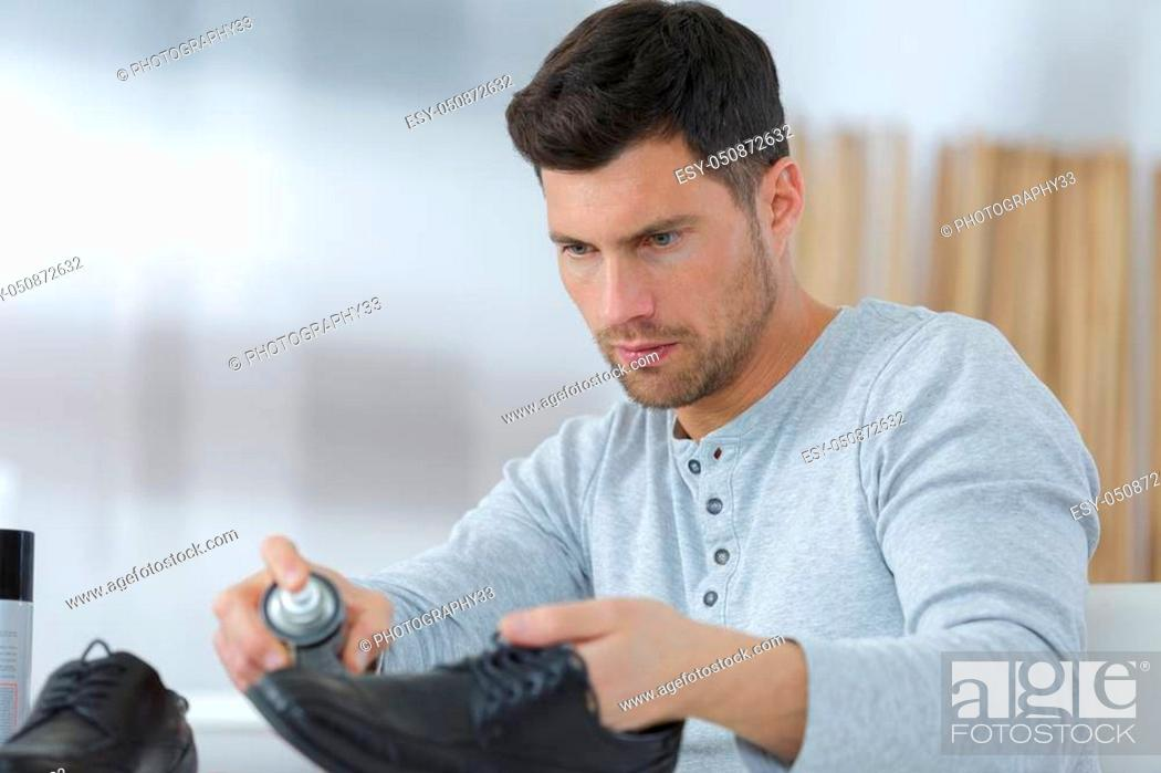 Stock Photo: man cleans his suede shoes.