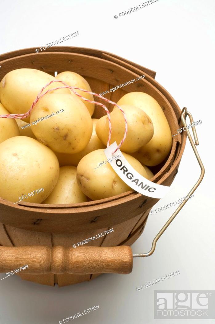 Stock Photo: Organic potatoes in woodchip basket.