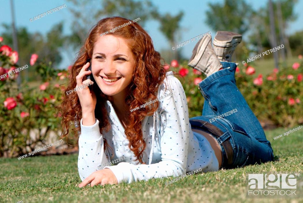 Stock Photo: talking woman on grass.