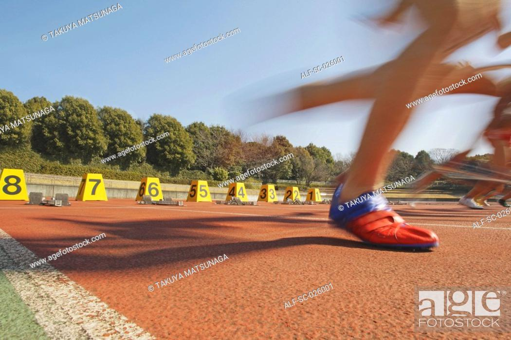 Stock Photo: Runners Starting Off.