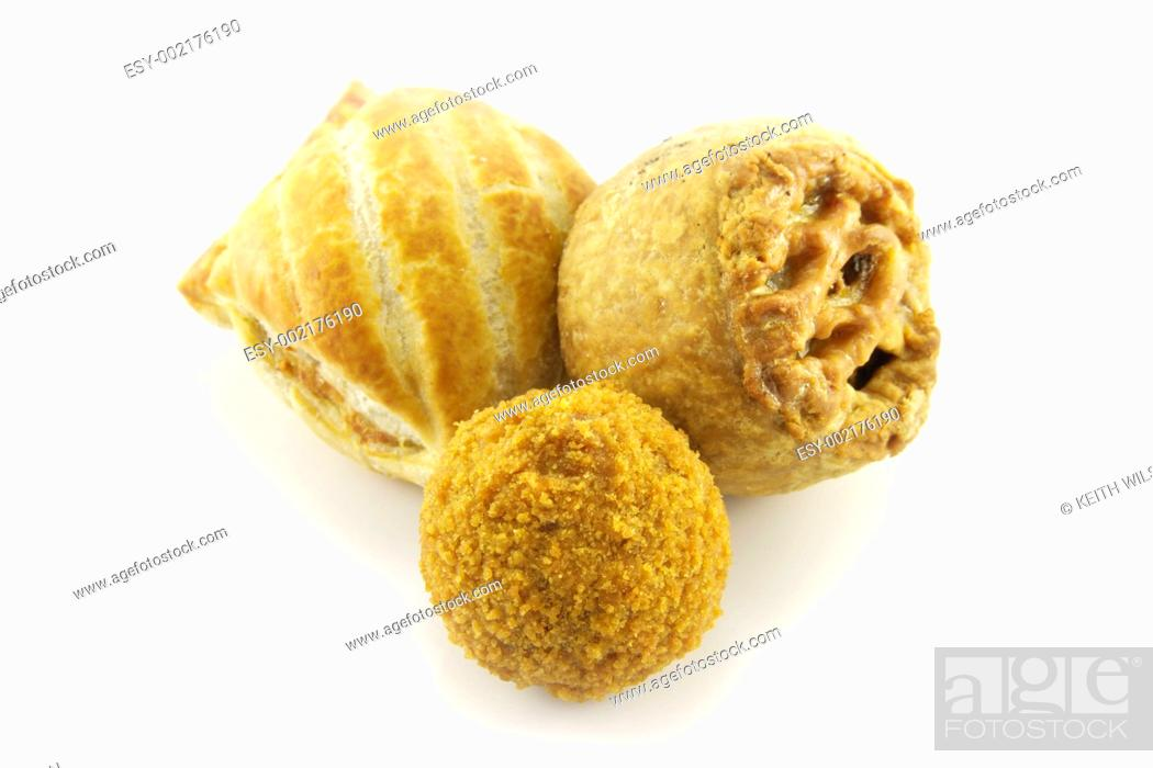 Stock Photo: Pork Pie with Scotch Egg and Sausage Roll.