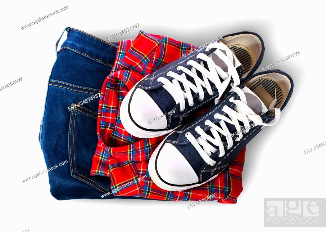 Stock Photo: Shirt jeans and sports shoes isolated on white background.