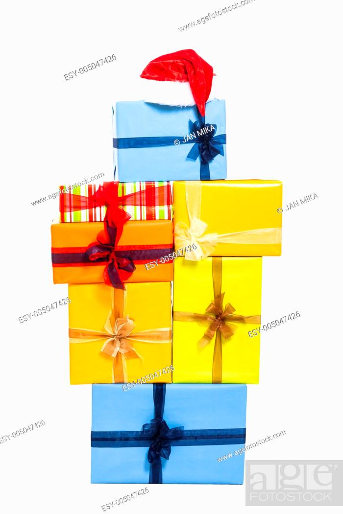 Stock Photo: Christmas Santa red hat and gift boxes, isolated on white background.