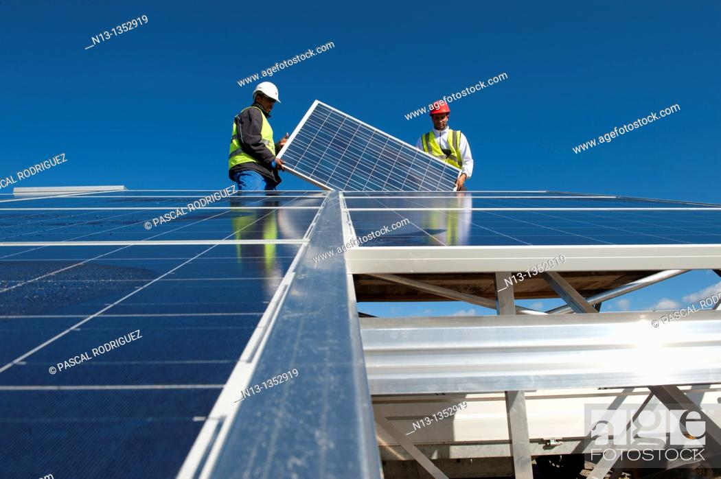 Stock Photo: Construction of solar panels for production of renewable electrical energy in the site of 'Puits Castan' old mine, Villaniere Aude Languedoc-Roussillon France.
