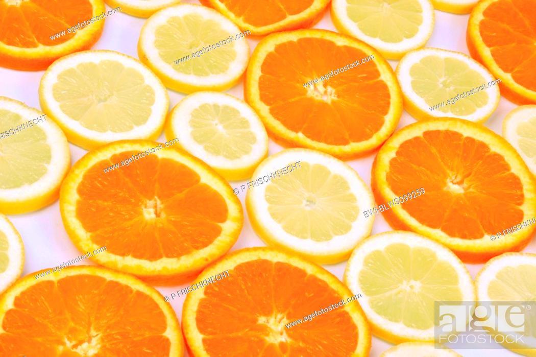 Stock Photo: orange Citrus sinensis, orange disks and lemon disks.
