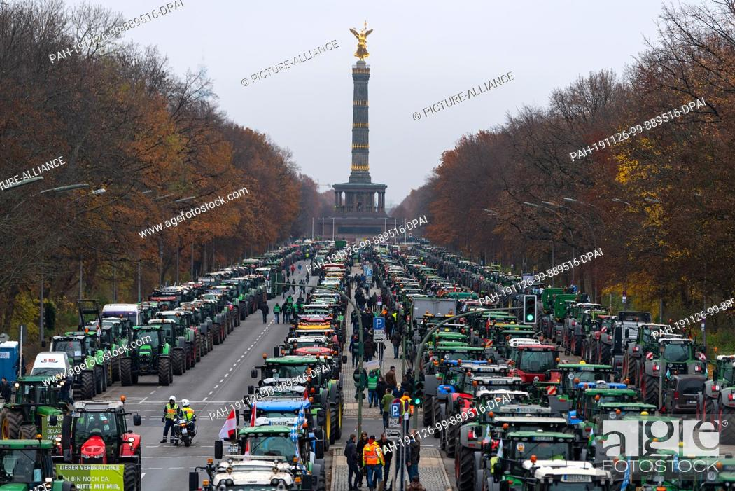 Stock Photo: 26 November 2019, Berlin: Numerous tractors are standing in front of the Victory Column during a protest action by farmers on the Straße des 17. Juni.