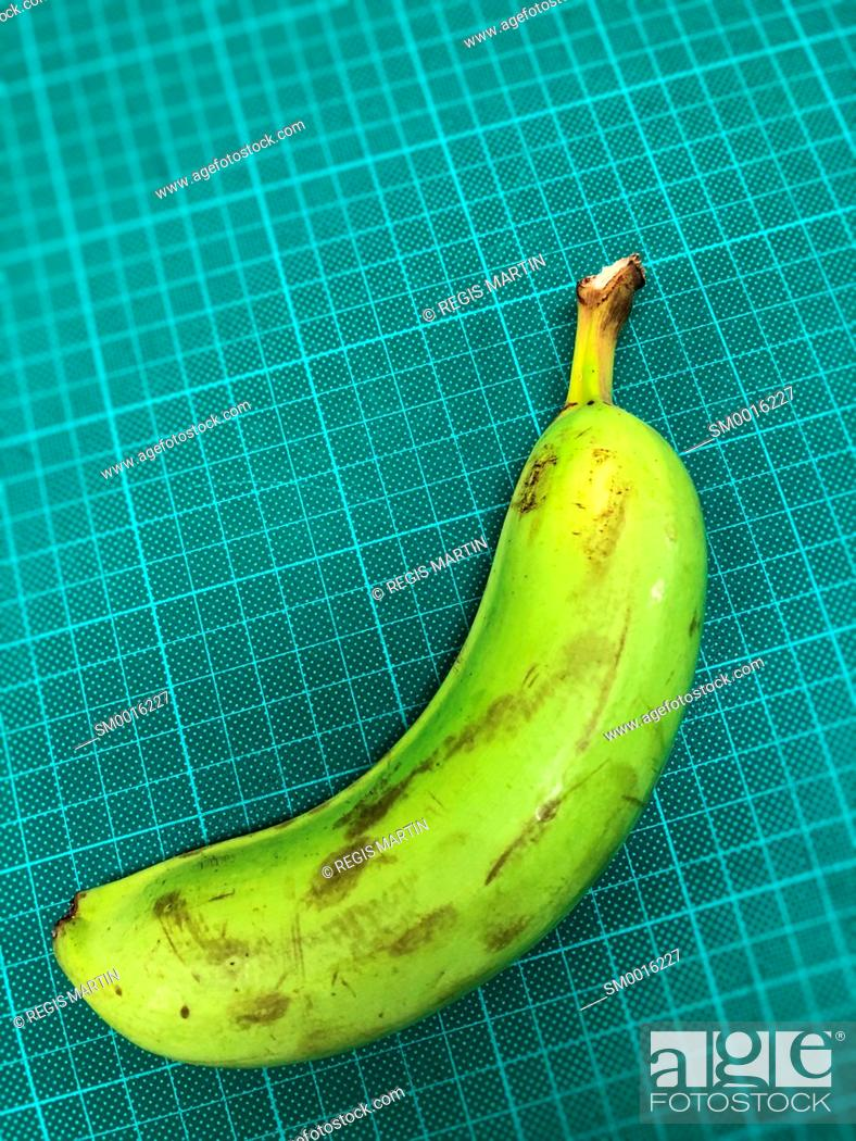 Stock Photo: One green banana.