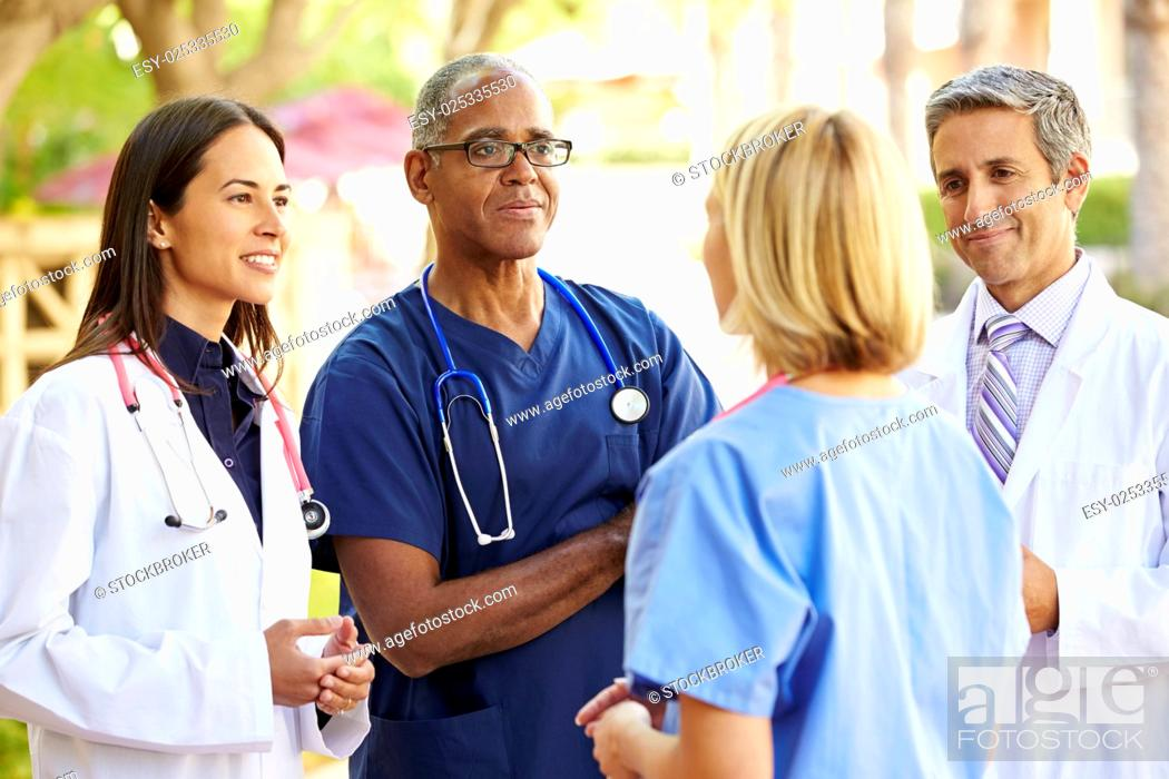 Stock Photo: Medical Team Having Discussion Outdoors.