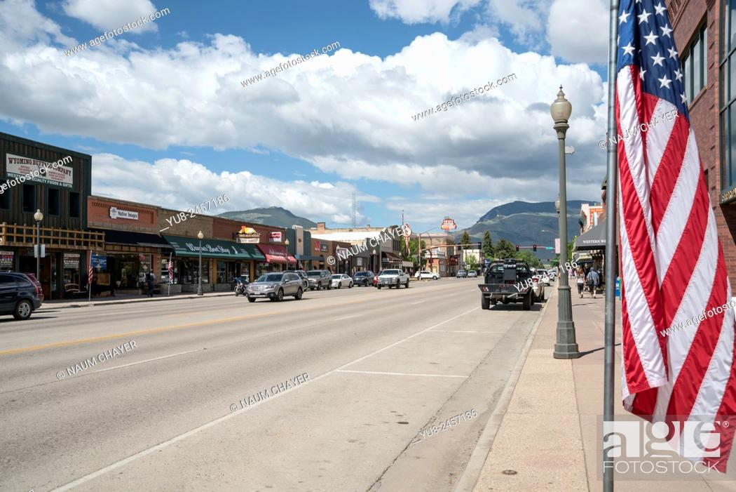 Stock Photo: Main street and American flag, Cody, Wyoming, United States, North America, USA.