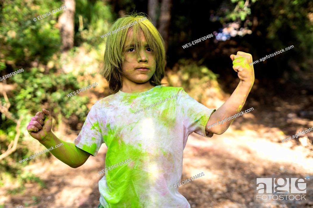 Stock Photo: Boy full of colorful powder paint, celebrating Holi, Festival of Colors.