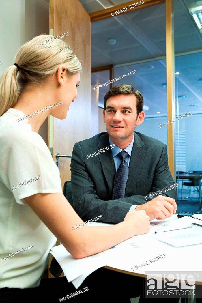 Stock Photo: Businesspeople having duscussion.