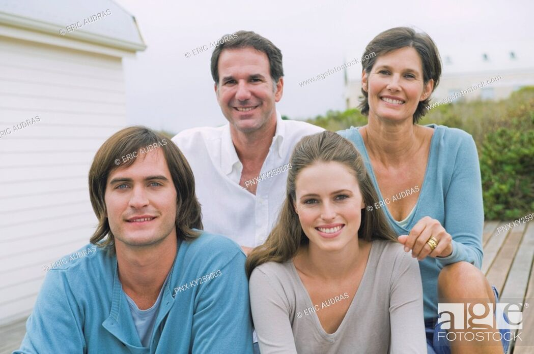 Stock Photo: Portrait of a family smiling together.
