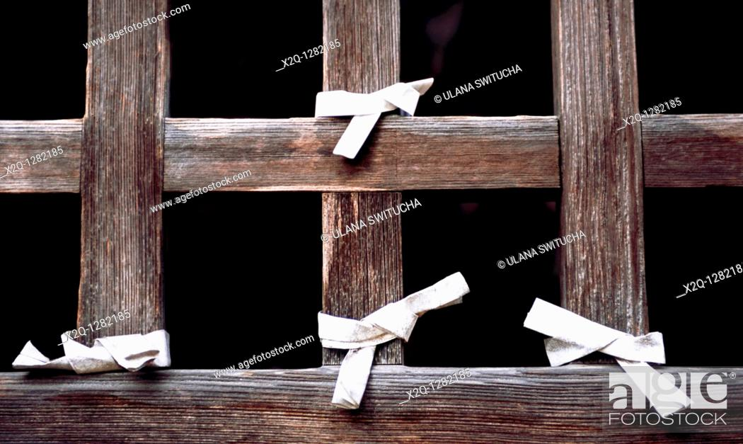 Stock Photo: Paper prayers tied to a temple window in Yamadera Yamagata Japan.