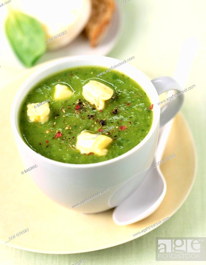 Stock Photo: courgette soup with goat's cheese.