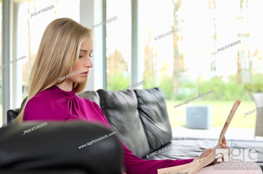 Stock Photo: Woman reading a newspaper.