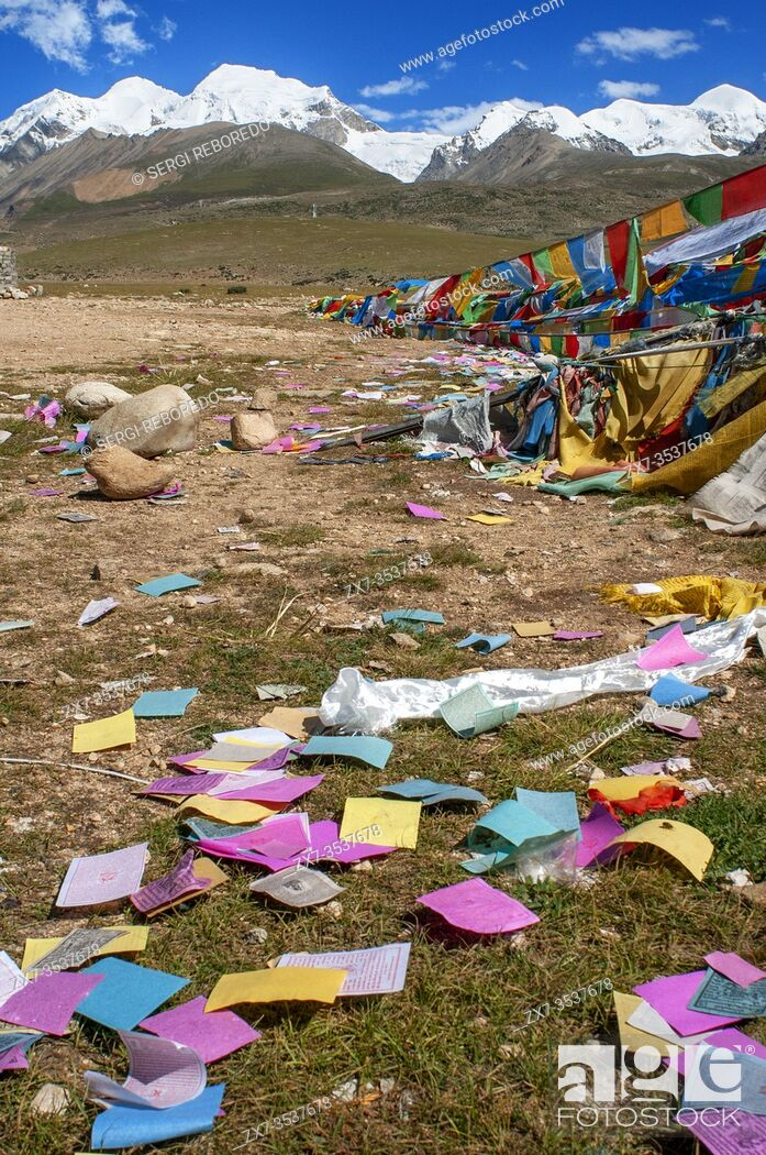 Stock Photo: Nyenchen Tonglha pass. Prayer flags next to the base of Mount Nyenchen Tanglha 7111 meters high, Tibet China. One of the holy mountains for Tibetans.