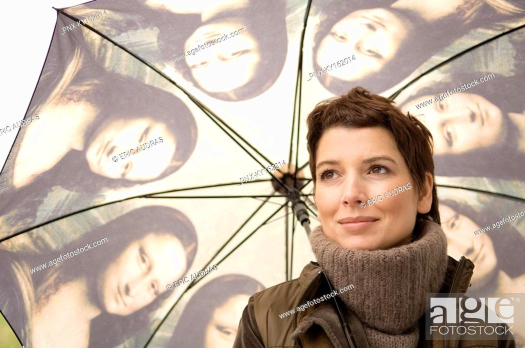 Stock Photo: Close-up of a mid adult woman holding an umbrella.