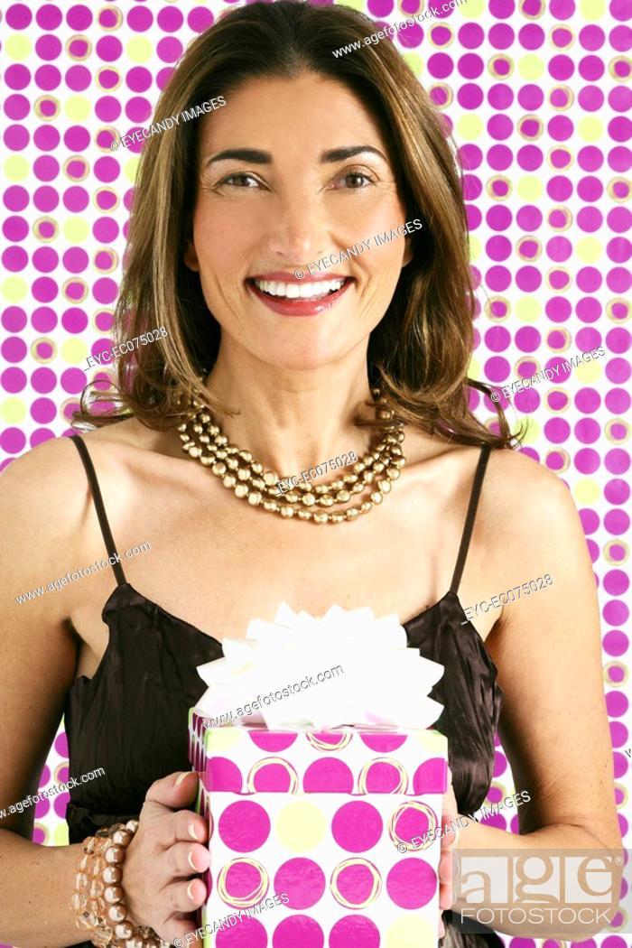 Stock Photo: Woman holding birthday present.