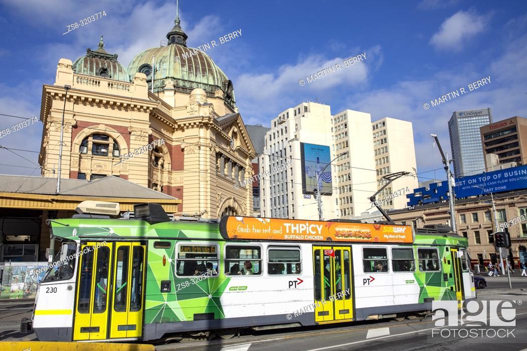 Stock Photo: Melbourne tram passes Flinders Street railway station. in Melbourne city centre.