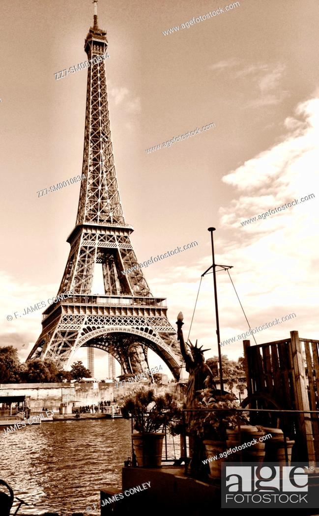 Stock Photo: A small Statue of Liberty salutes the Eiffel Tower.