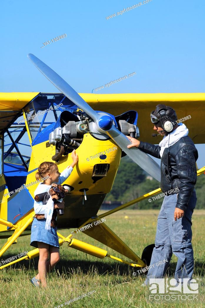 Stock Photo: A father private pilot with his young daughter around a famous Piper J-3 Cub.