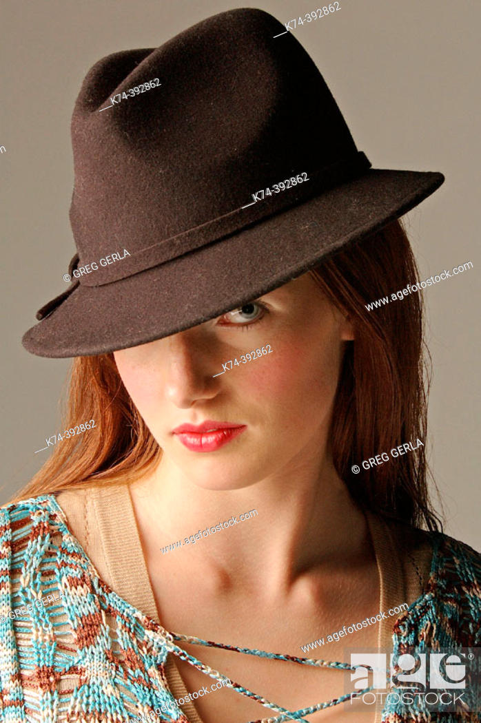 Stock Photo: Image of young woman wearing hat.