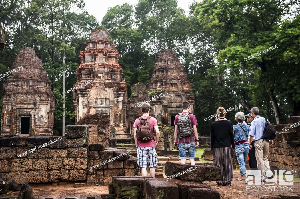 Stock Photo: Tourists visiting Preah Ko temple in Angkor Complex (Siem Reap Province, Cambodia).