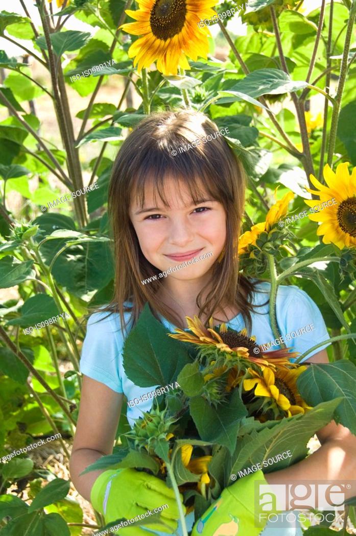 Stock Photo: Girl and sunflowers.
