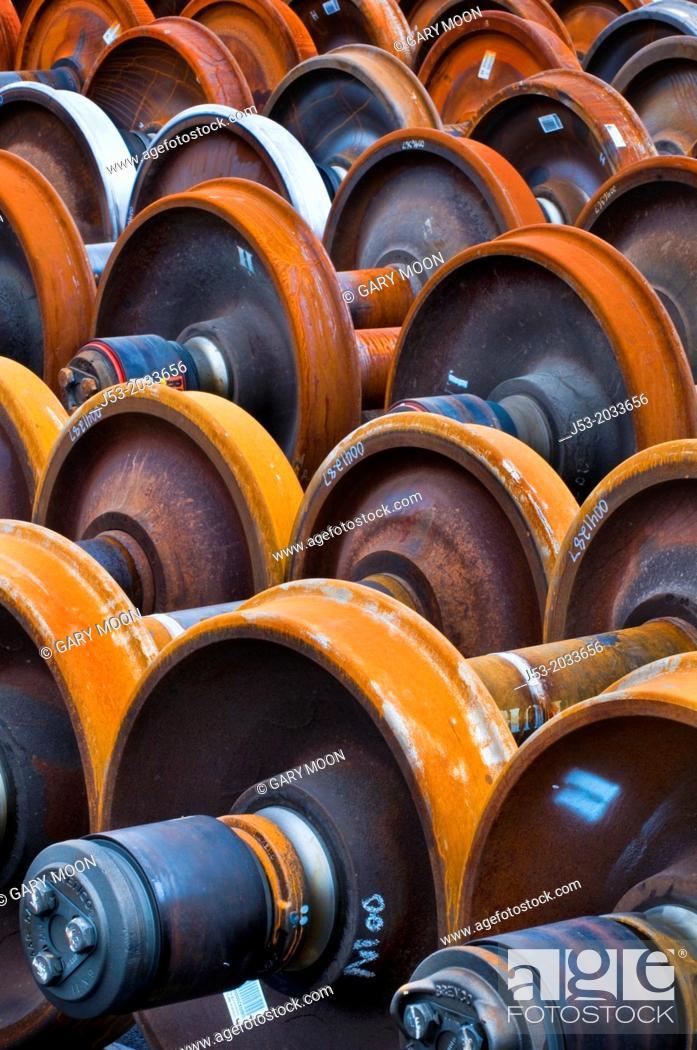Stock Photo: Railroad train wheel and axle assemblies at manufacturing plant, Tacoma, Washington USA.