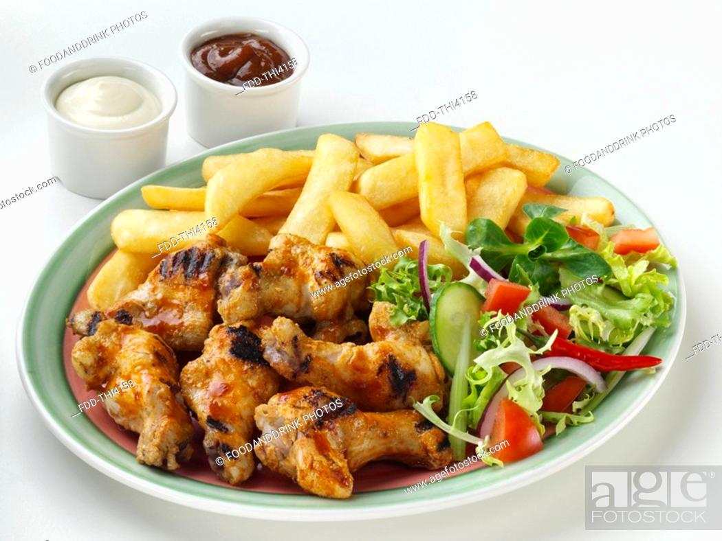 Stock Photo: Chicken Wing, Chips & Salad.