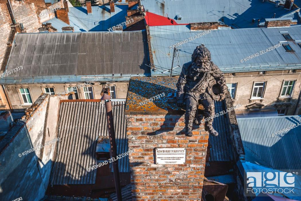 Stock Photo: Chimney sweeper sculpture on the roof of famous restaurant House of Legends on the Old Town of Lviv city, largest city in western Ukraine.