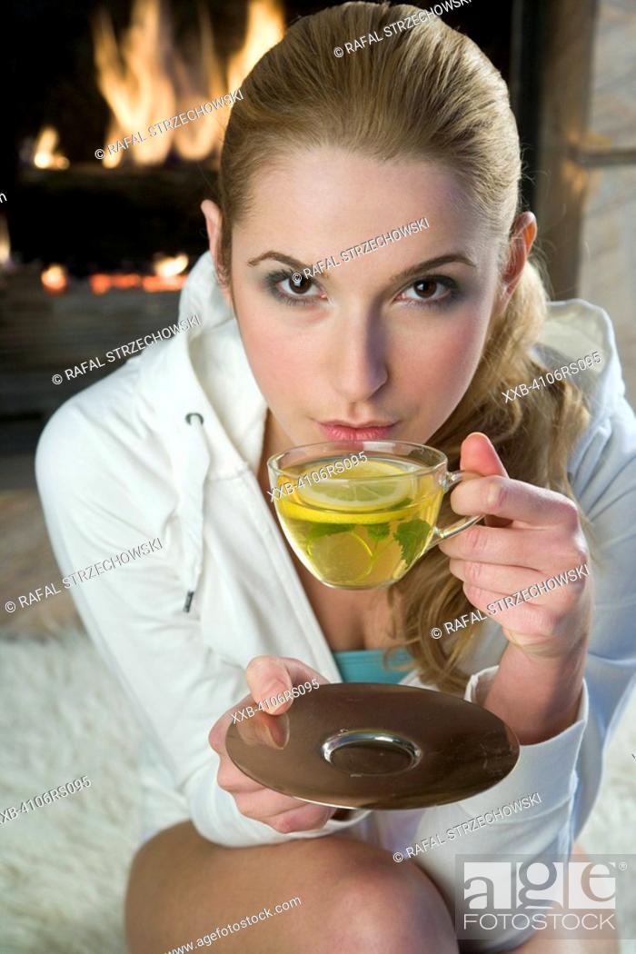Stock Photo: woman drinking lemon tea.