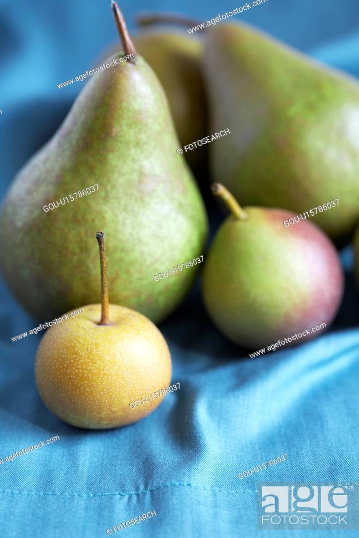 Stock Photo: Selection of pears and apples.