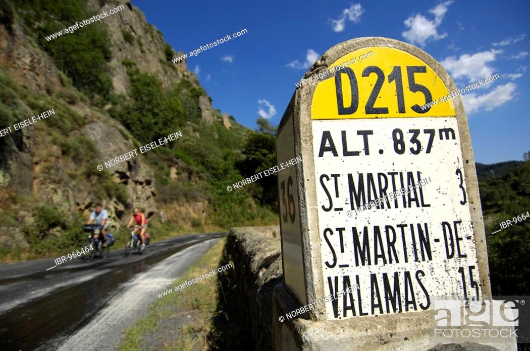 Stock Photo: Information on distances, cyclists near Saint Martial, Ardèche, Rhones-Alpes, France, Europe.