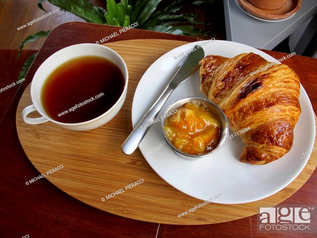 Stock Photo: Tea, croissant and marmalade.
