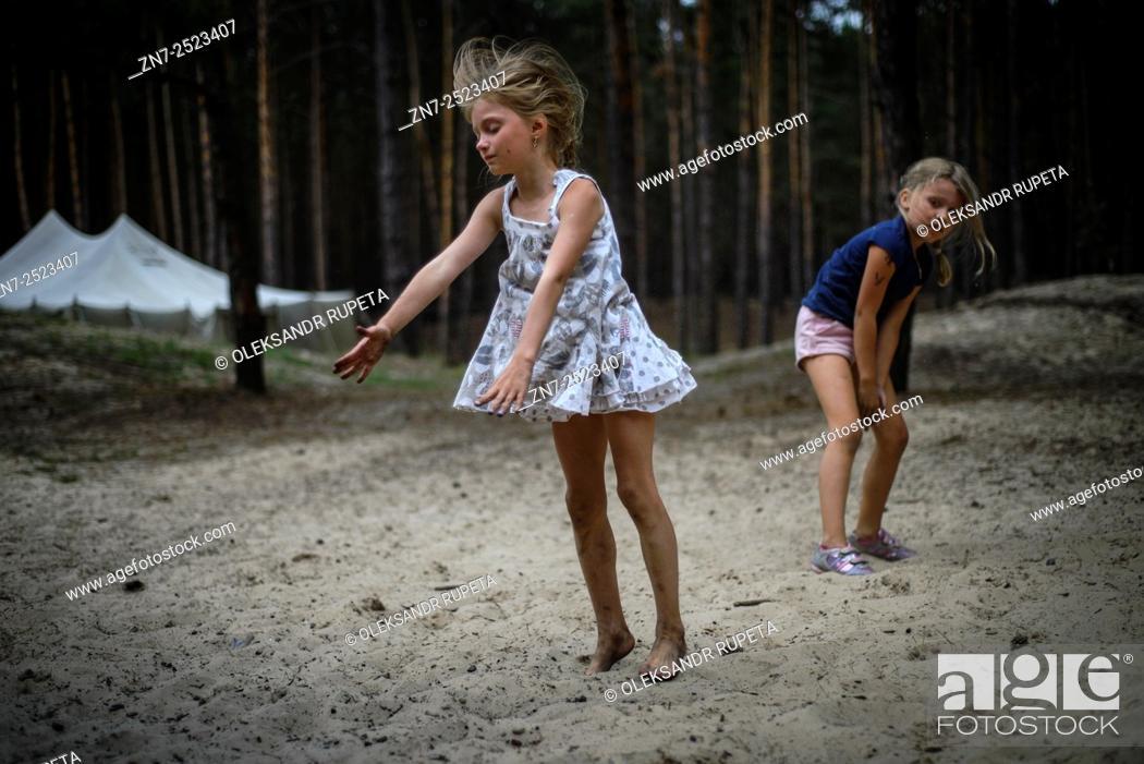 Stock Photo: Female dancers performing in nature, Ukrainian scout training camp, Kiev region, Ukraine.