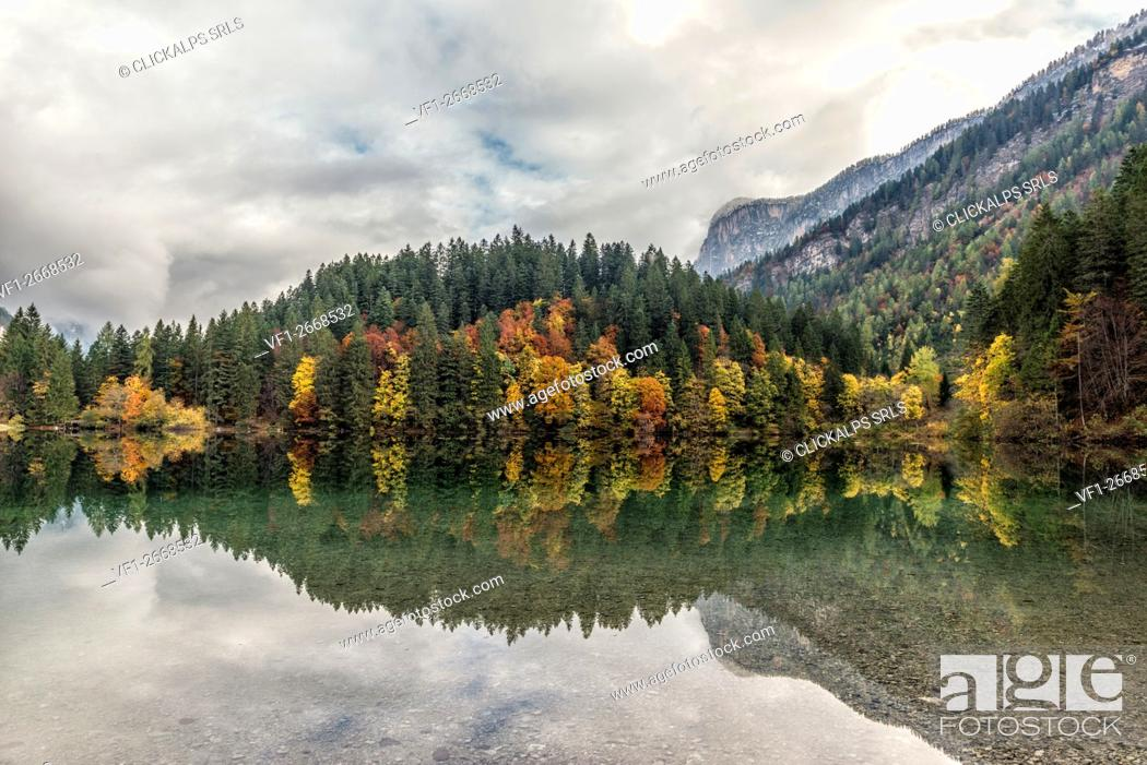 Stock Photo: Italy, Trentino Alto Adige, Non valley, clouds reflected into Tovel lake in autumn.