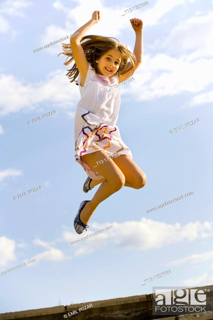 Stock Photo: Young girl caught in mid-air.