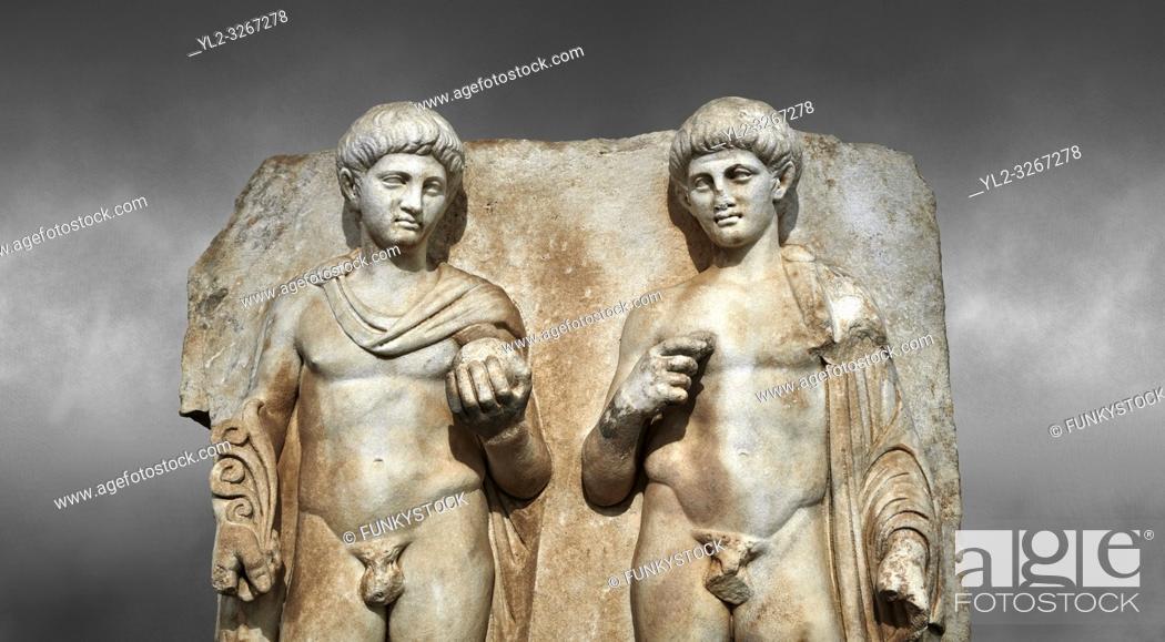 Stock Photo: Close up of a Roman Sebasteion relief sculpture of Two princes, Aphrodisias Museum, Aphrodisias, Turkey. Against a grey background. .