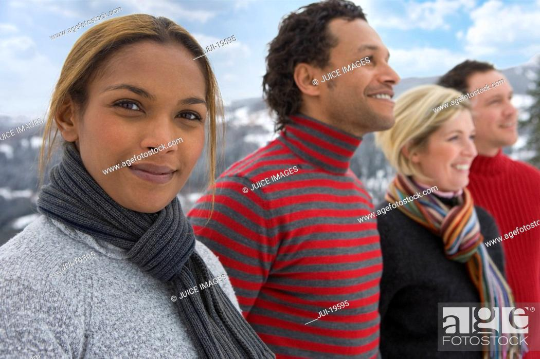 Stock Photo: Two couples standing outdoors in winter setting.