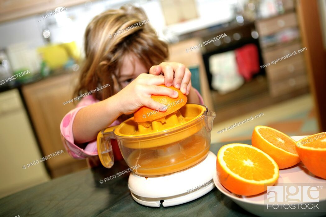 Stock Photo: Girl preparing orange juice.