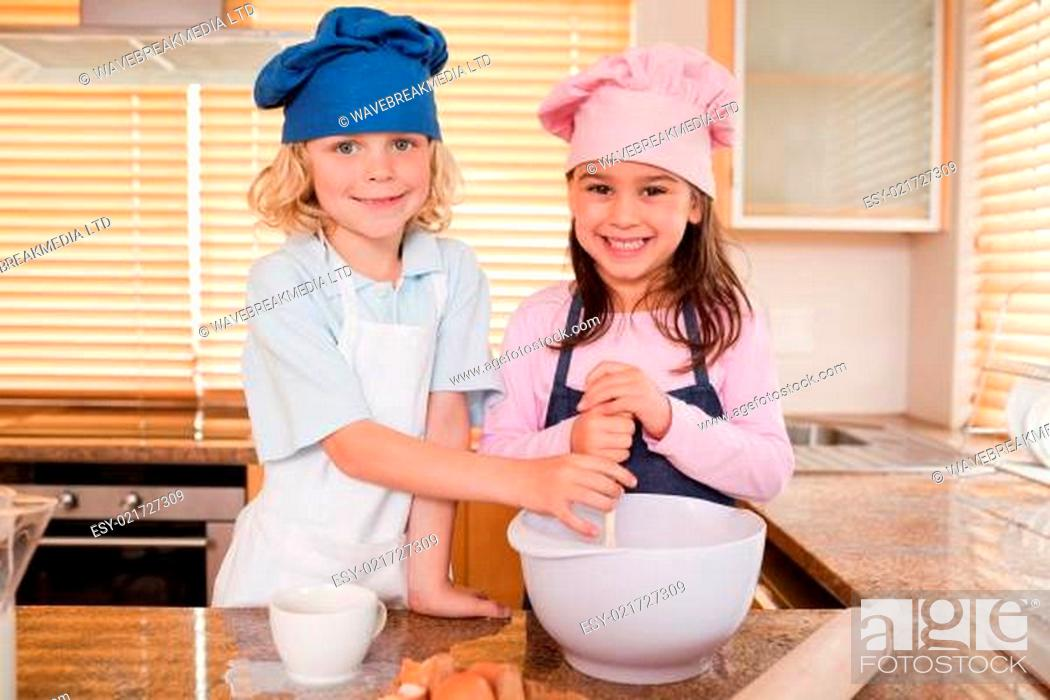 Stock Photo: Siblings baking together.