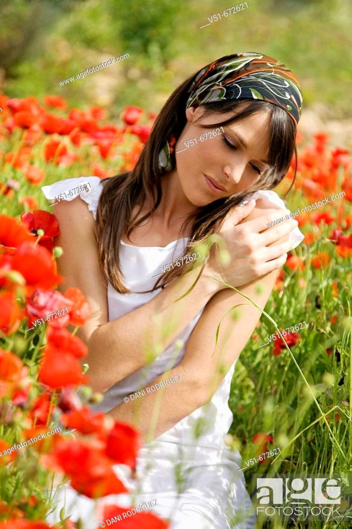 Stock Photo: Young woman feeling good in the countryside.