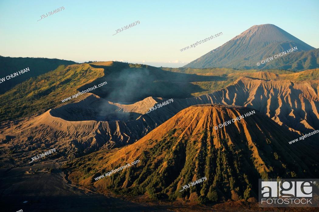 Stock Photo: View of Caldera Tengger with volcanoes at sunrise, smoking volcano Gunung Bromo, with Mt. Batok, Mt. Kursi, Mt. Gunung Semeru.