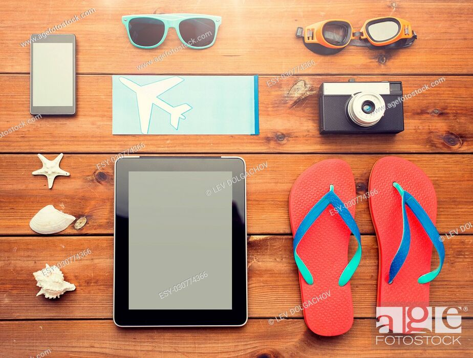 Stock Photo: vacation, travel, tourism, technology and objects concept - close up of tablet pc computer and travel stuff.